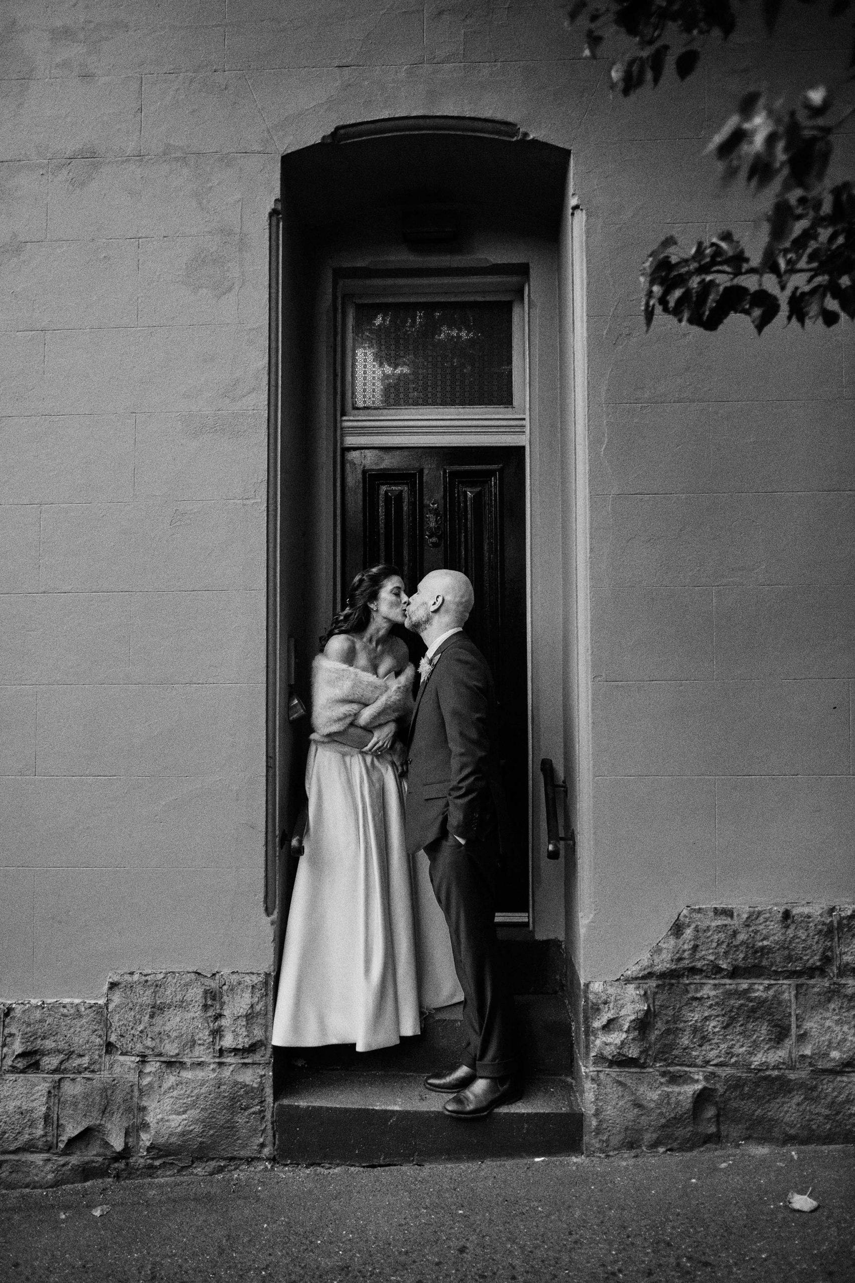 East Melbourne Wedding rain portrait bride groom umbrella elegant kiss