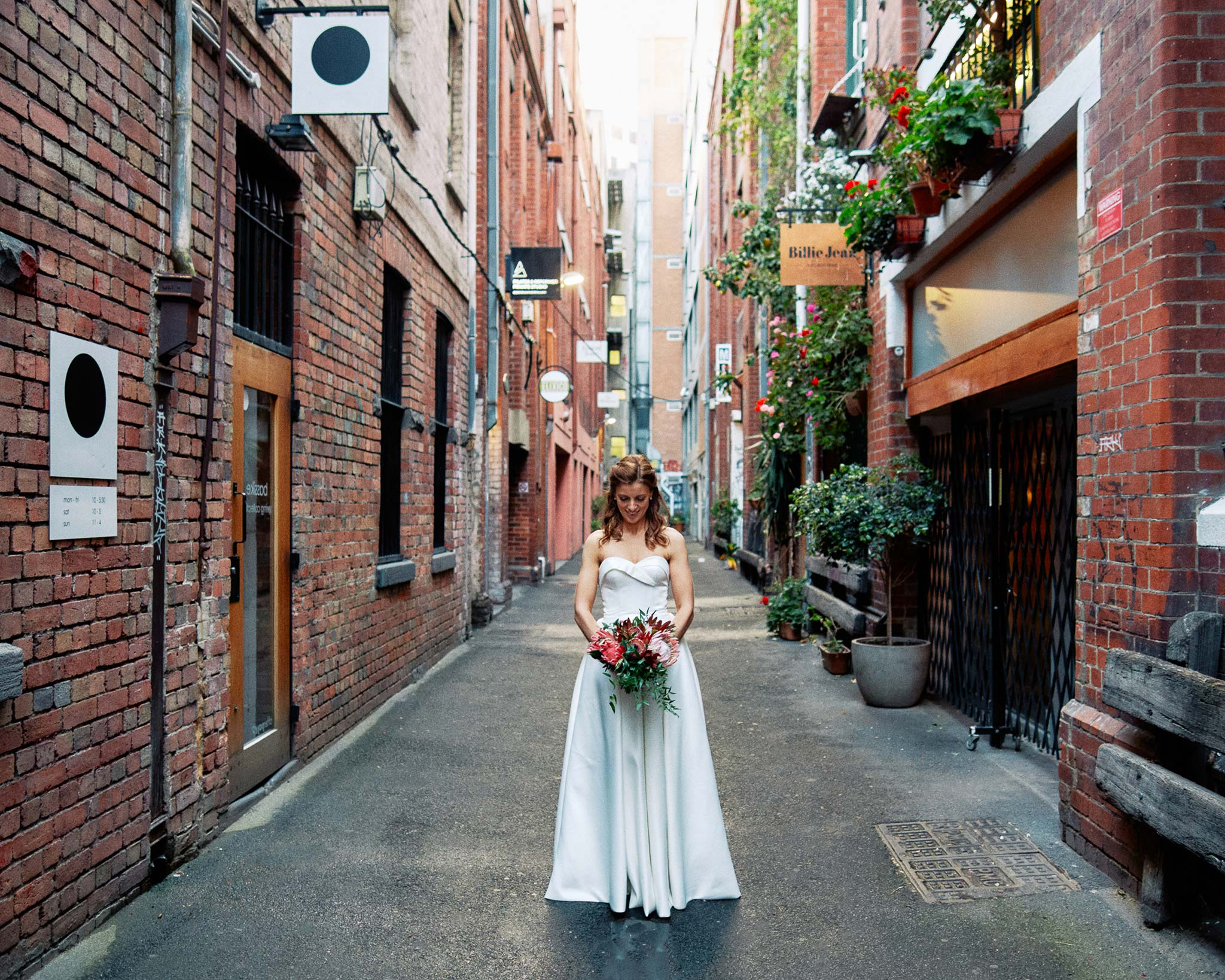 Melbourne Wedding Hardware Lane alley portrait bride holding bouquet in alleyway