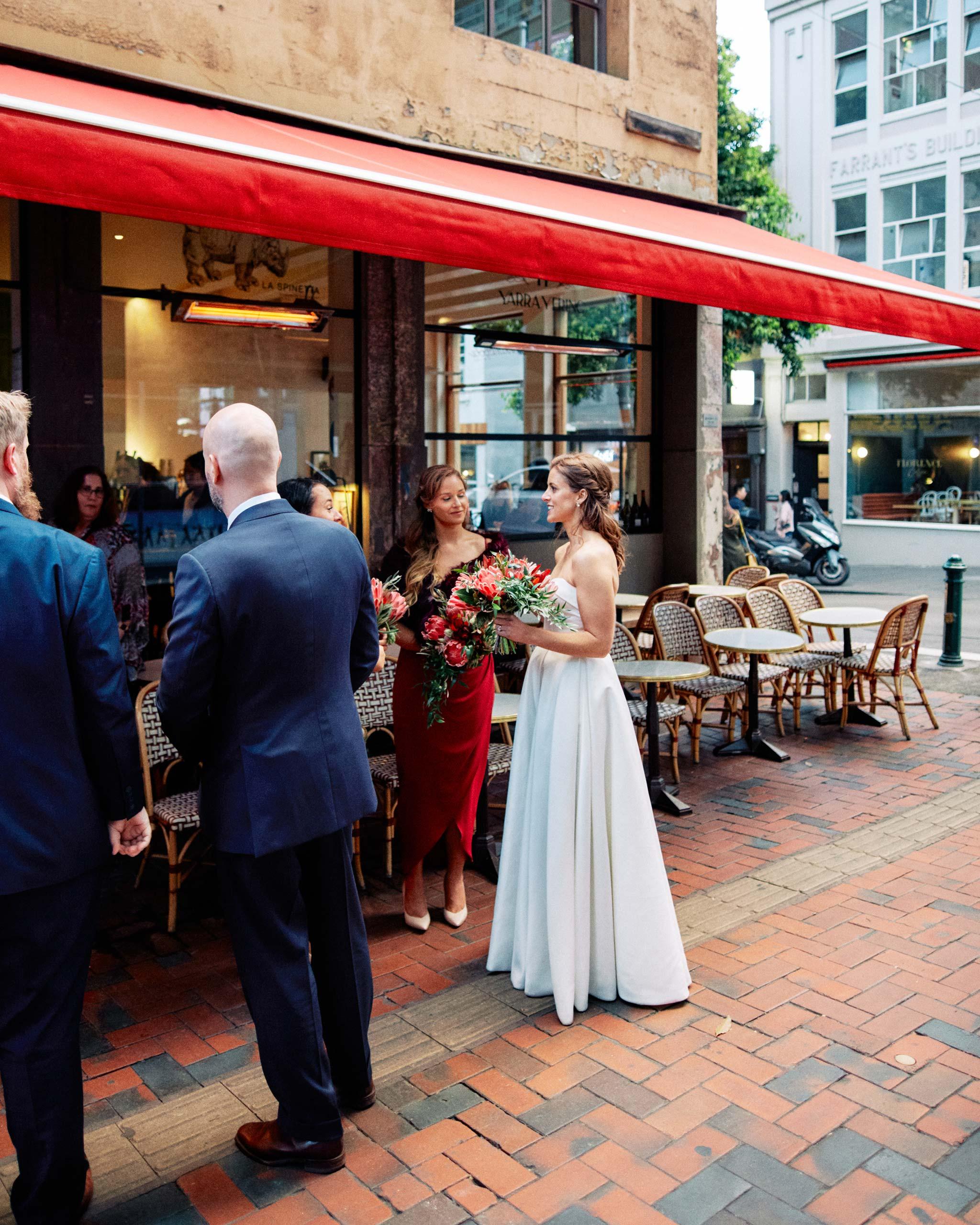 Classic Melbourne Wedding Bride Groom walking towards french saloon reception