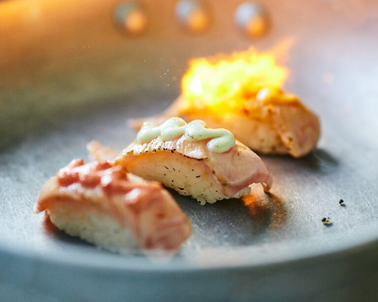 close-up-photo-aburi-salmon-nigiri-sushi