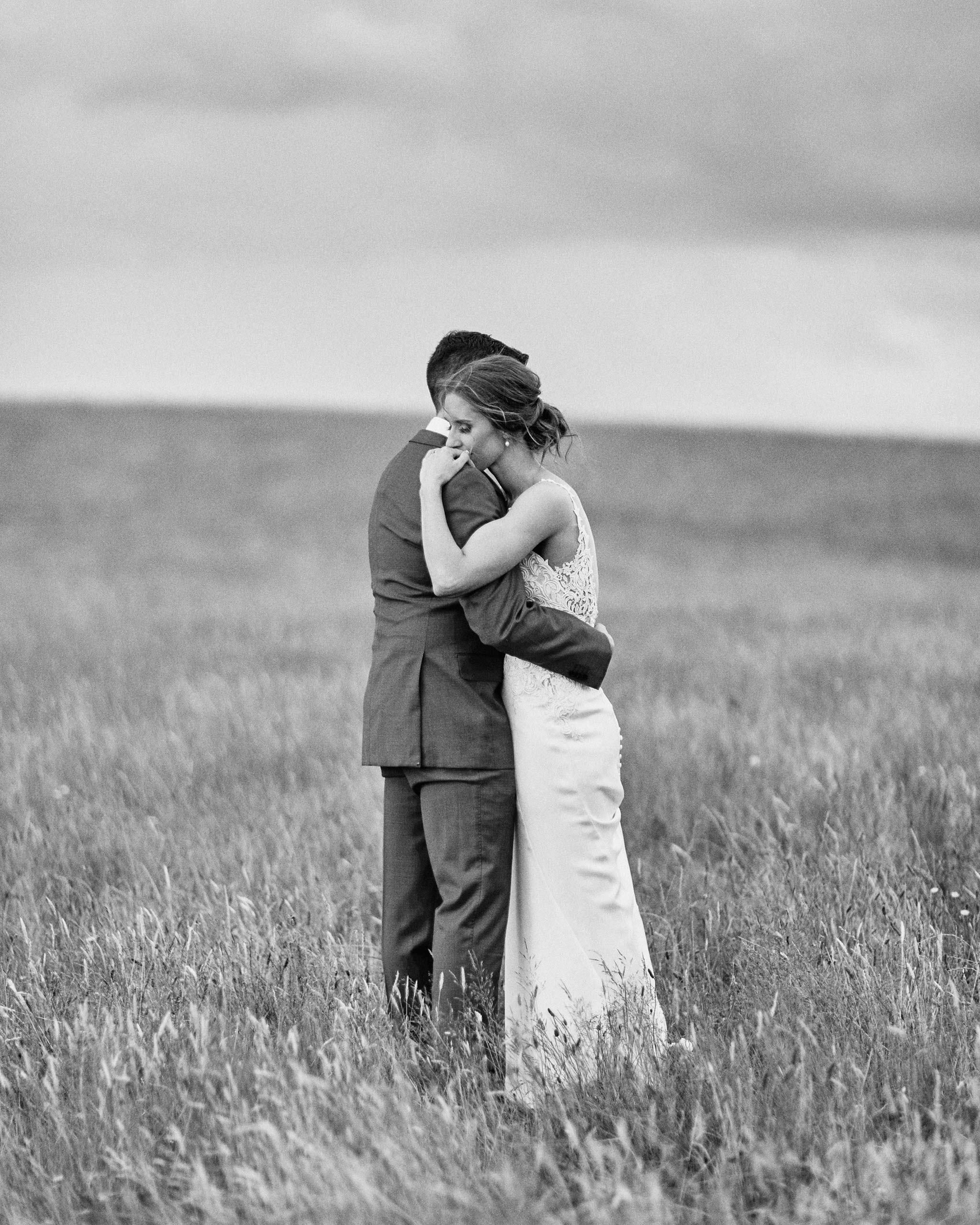 Zonzo estate wedding field couple embrace