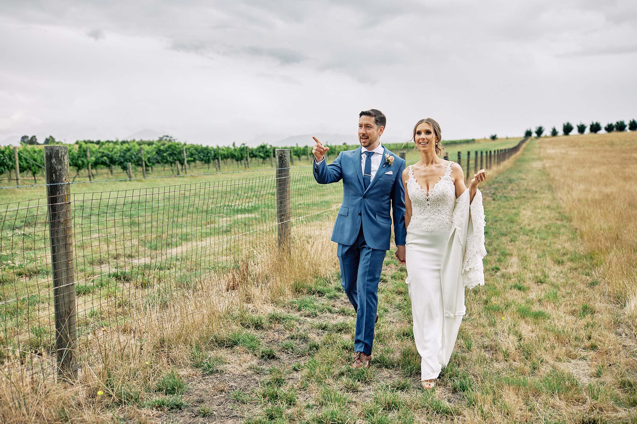 Zonzo estate wedding couple walking back