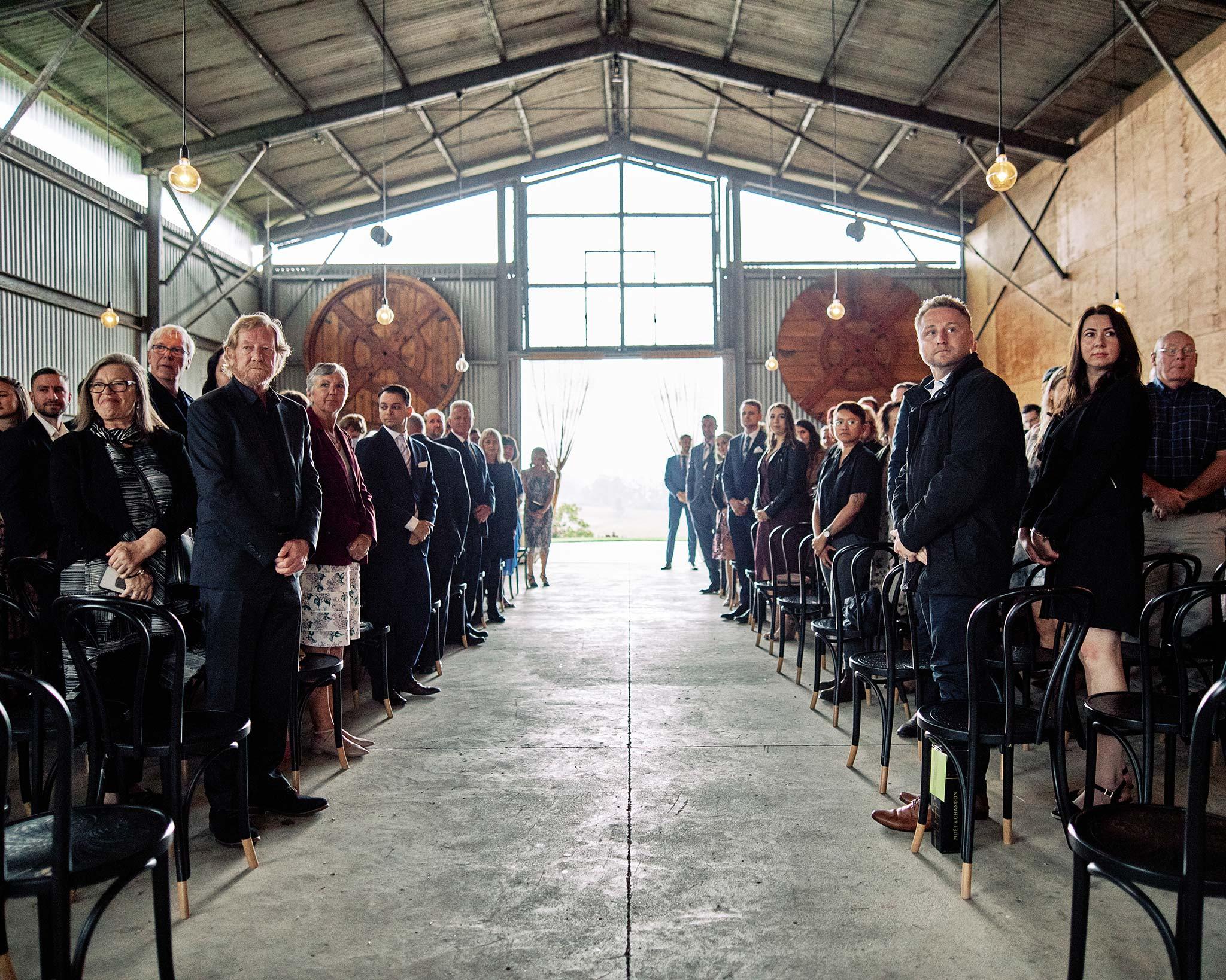 Zonzo estate wedding guests standing