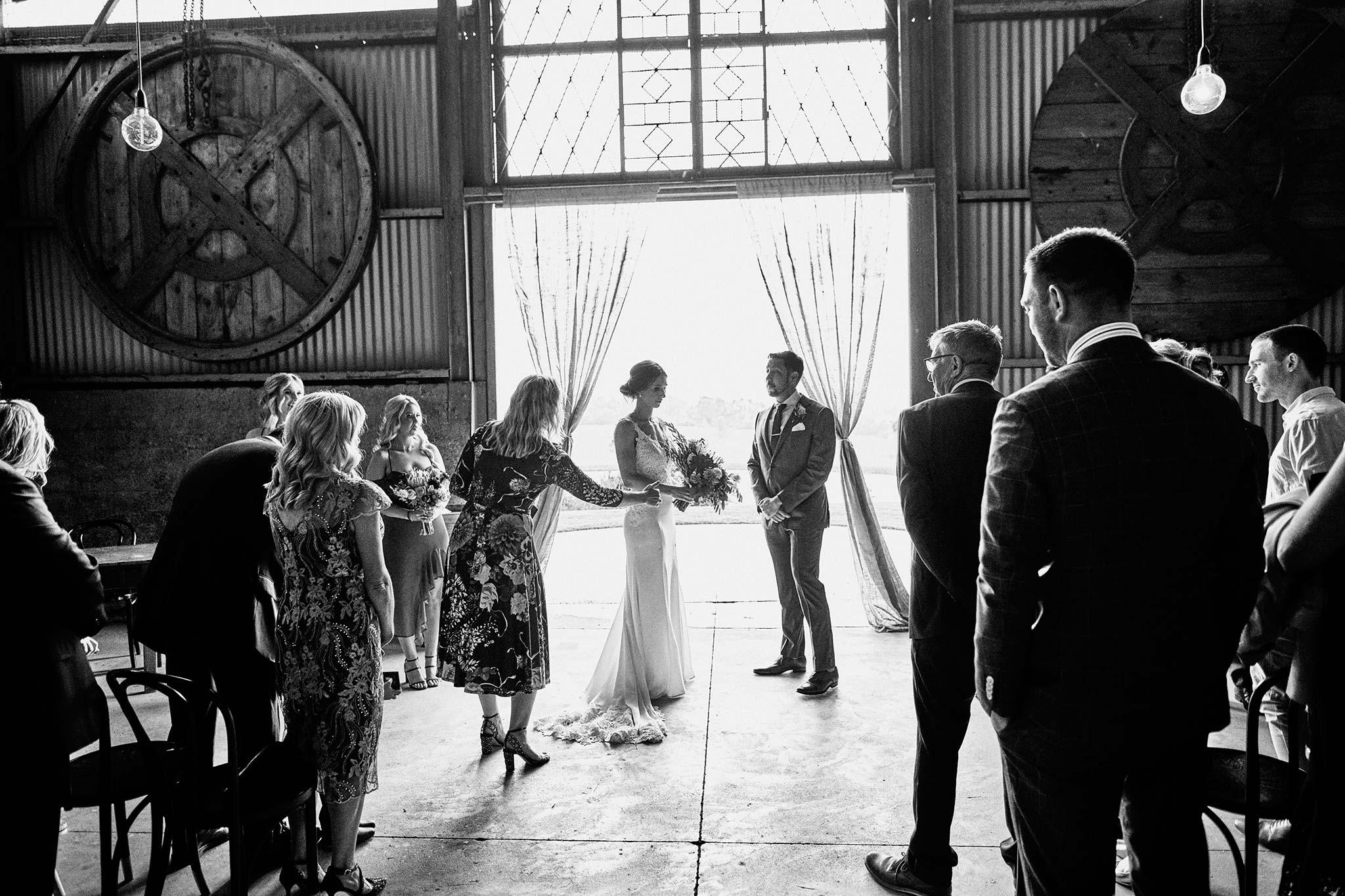 Zonzo estate wedding ceremony backlit