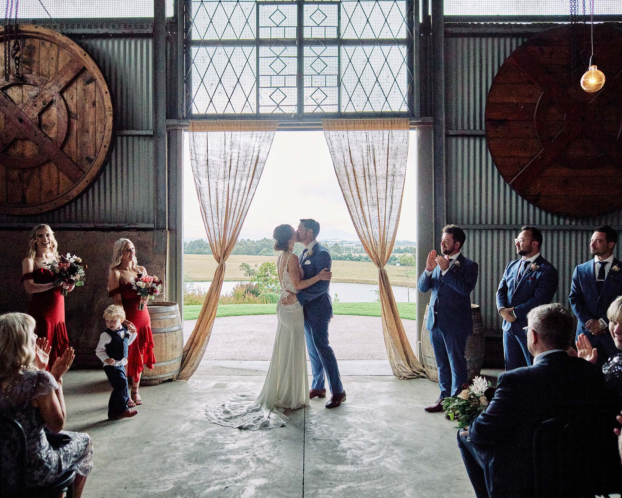 Zonzo estate wedding ceremony kiss