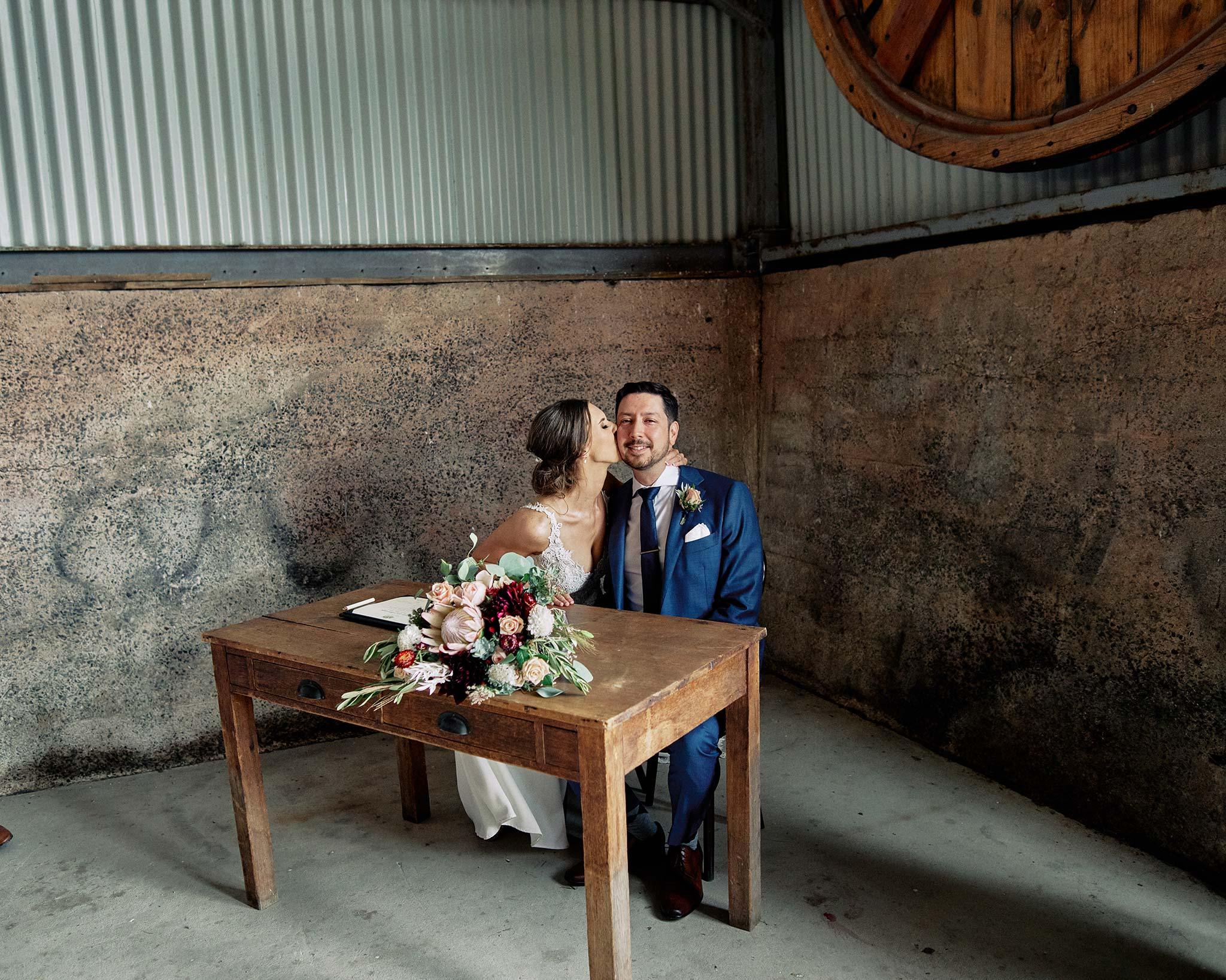 Zonzo estate wedding signing of paper kiss