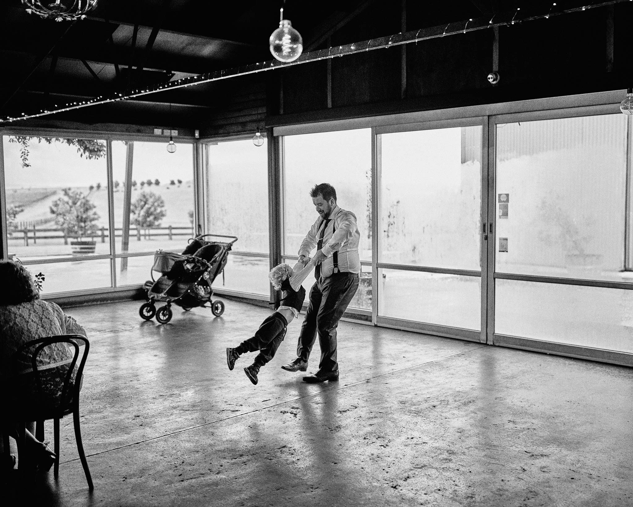 zonzo wedding photography reception dad playing with son