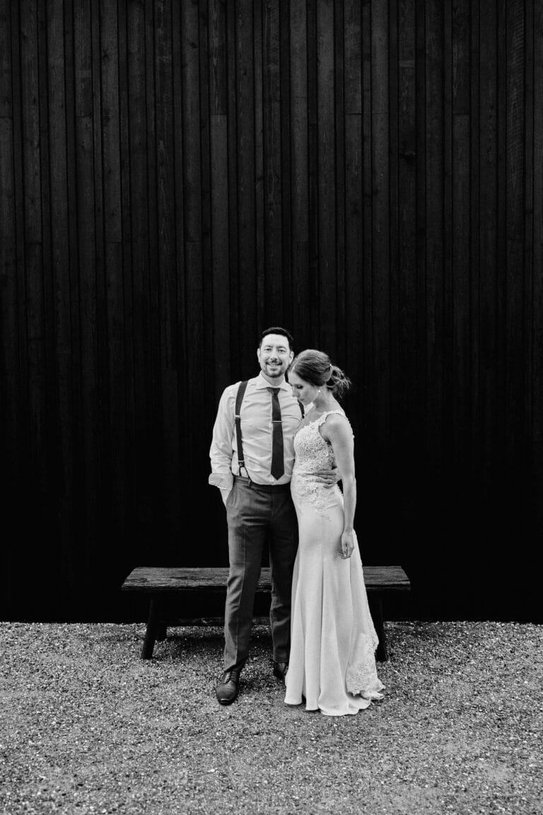 portrait of a couple in front of black wall at Zonzo Yarra Valley Melbourne