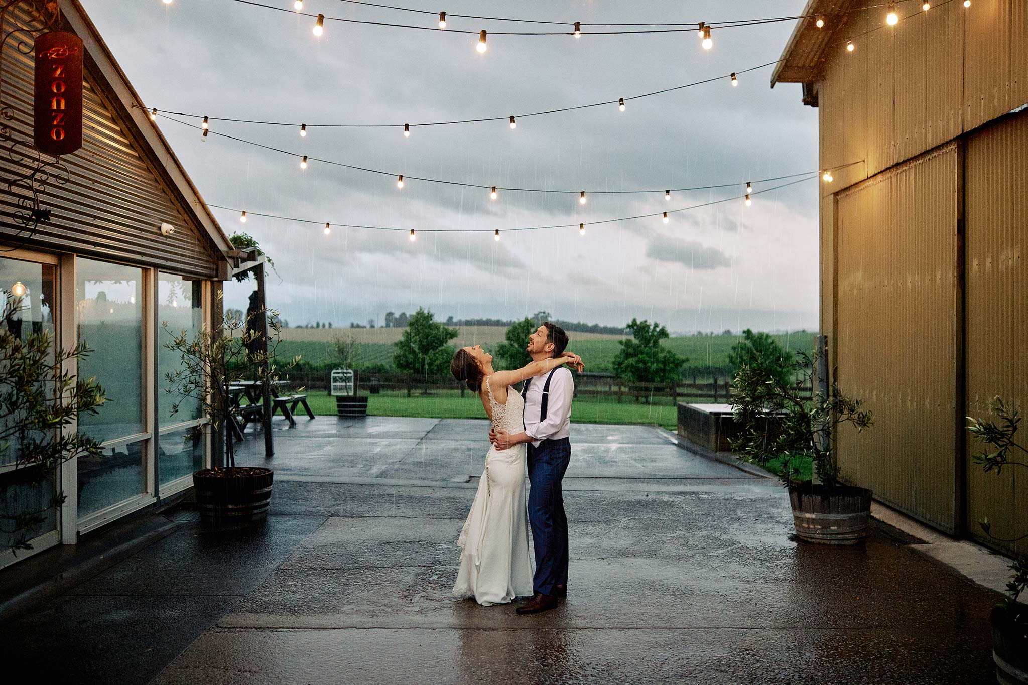 zonzo wedding photography reception bride groom portrait in rain
