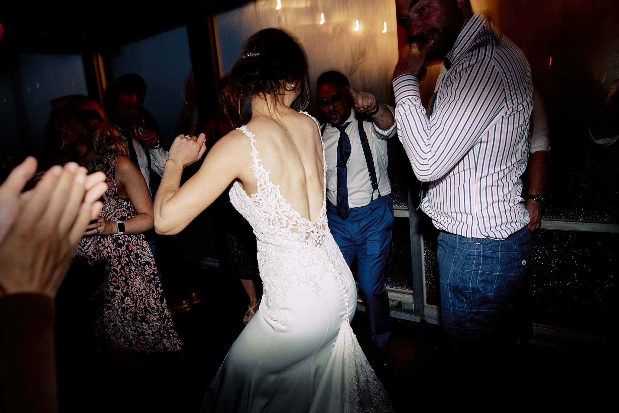 zonzo wedding photography reception dance floor bride back view